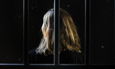 Image of woman behind bars